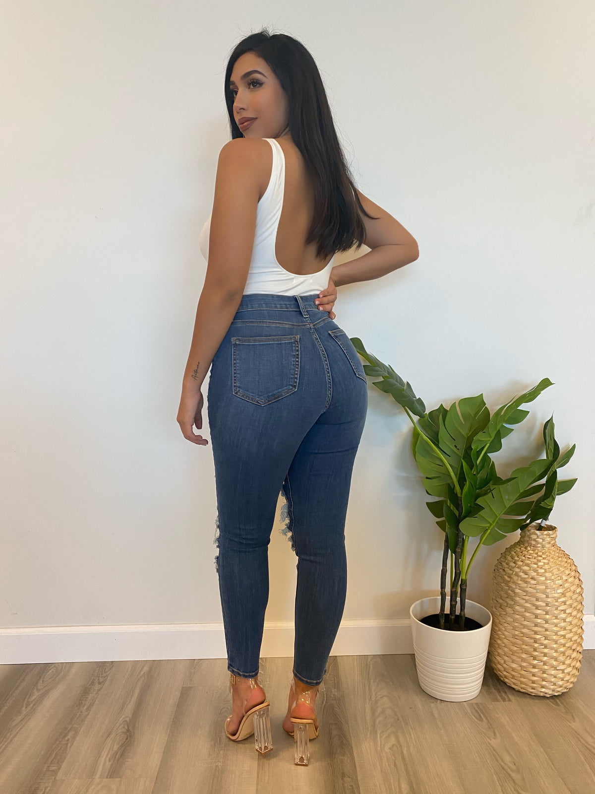 denim high rise jeans, distressed at the knees and high thigh, length to above ankle.