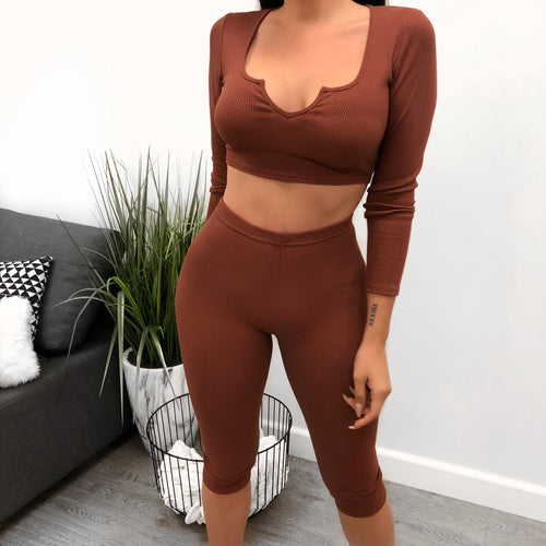 rust two piece set. long sleeve crop top with sweet heart neckline. high waisted leggings, up to knee length.