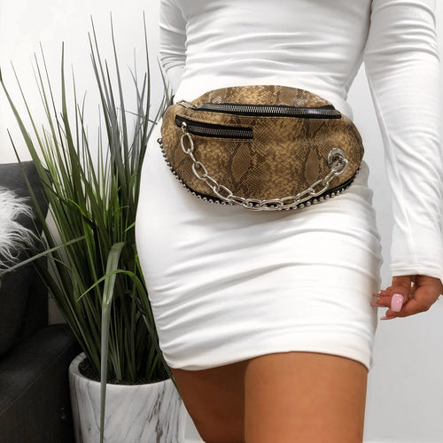 tan snake print fanny pack. silver chain. ties around the waist.