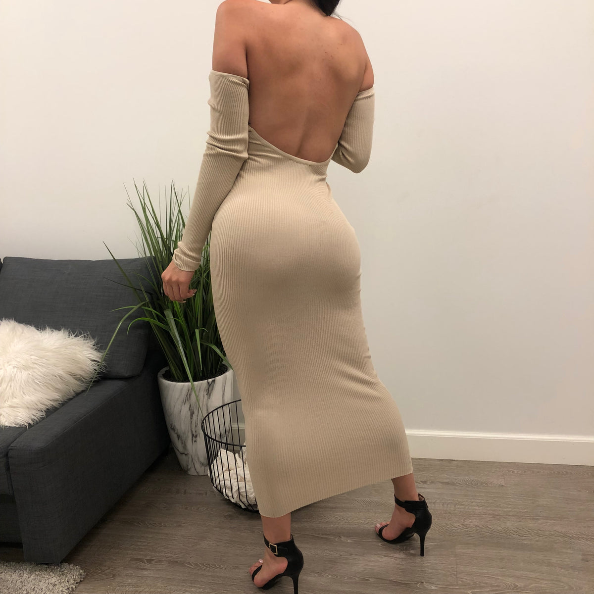 nude strapless long sleeve tight dress. low u cut back. dress length is to ankles.