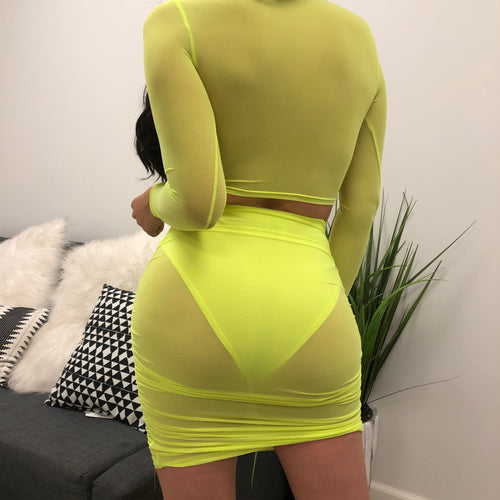 mesh neon two piece. long sleeve mesh top with funnel neckline. see through.  skirt is mesh and above the knee length. Undergarments not included.