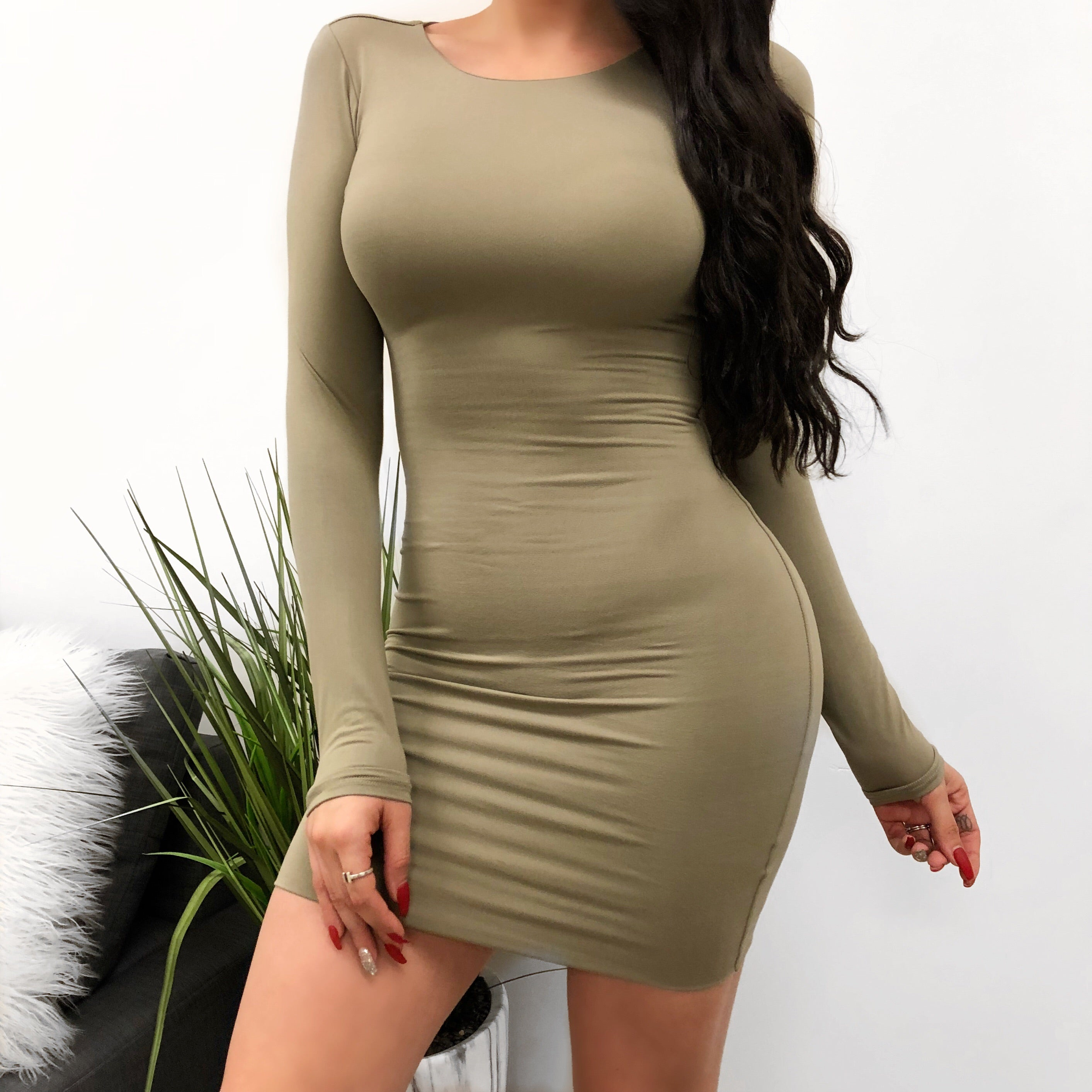 taupe wide crew neck long sleeve dress. dress hugs the body and arms. dress length is to mid thigh.