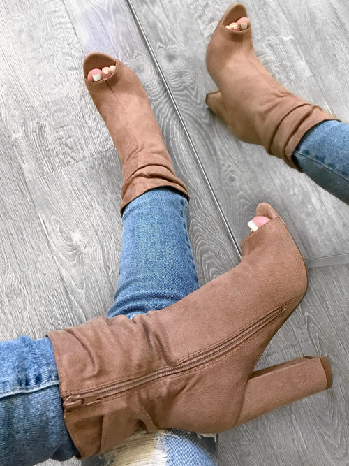 Heel about 3.5 inches tall, suede booties with open toed. Length to above ankle