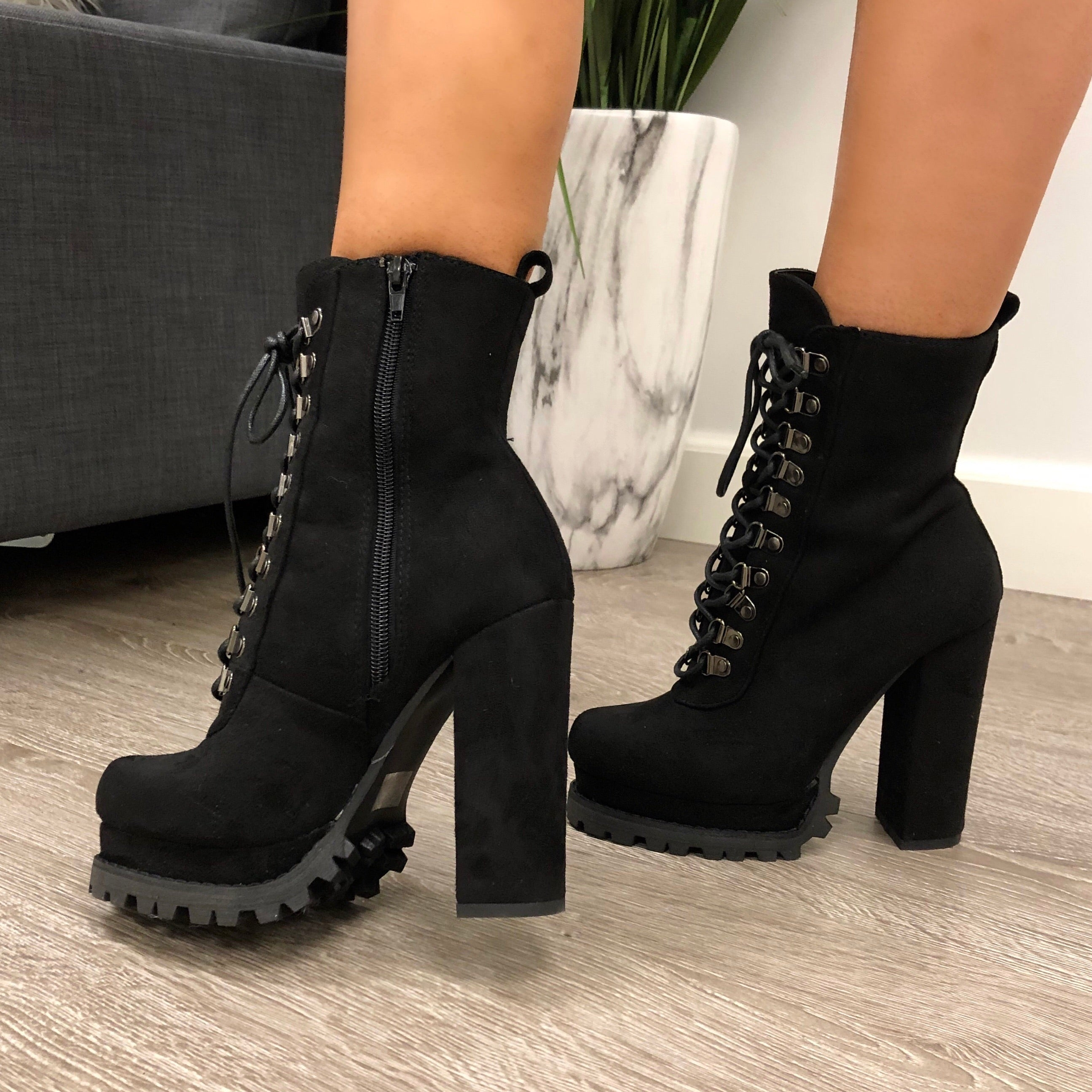 Black tall bootie about 4 inches tall. Has a lace up on the front. Can be worn with shorts or jeans.
