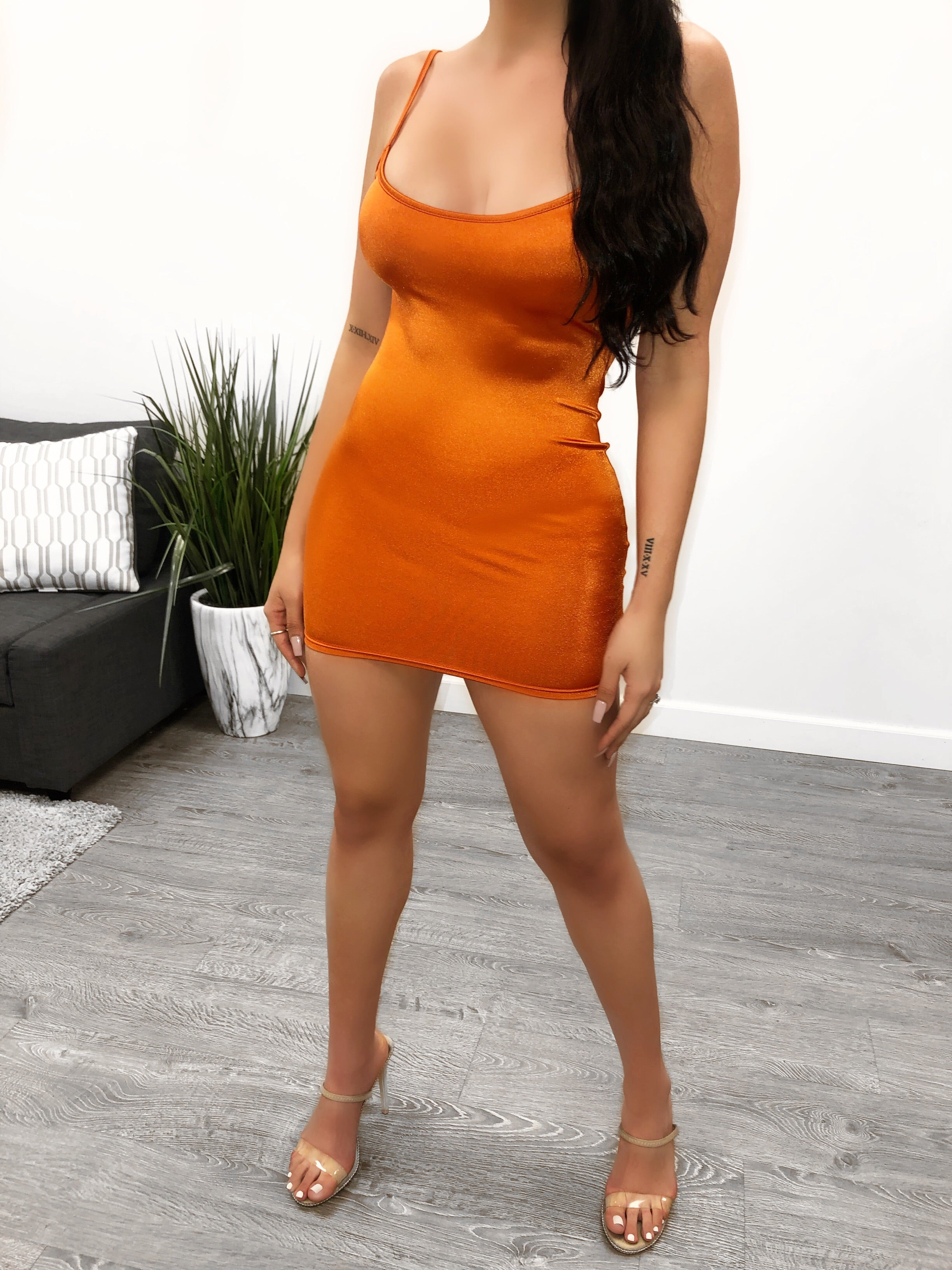 Rust satin spaghetti strapped dress, length mid thigh, mid cleavage