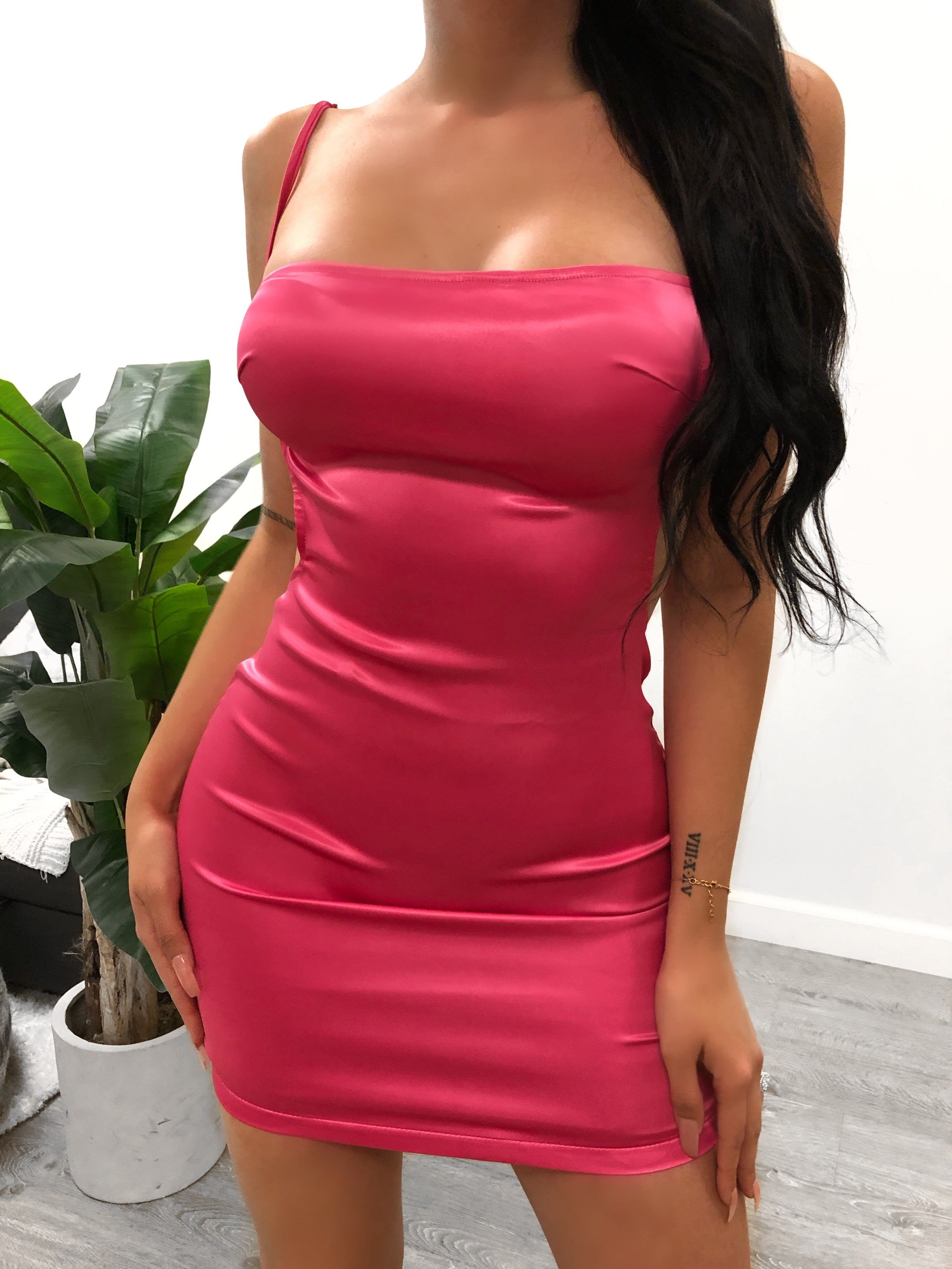 hot pink Satin backless dress,back has backless scoop, has adjsutbale straps. Dress is midi length. Dress comes in multiple colors.