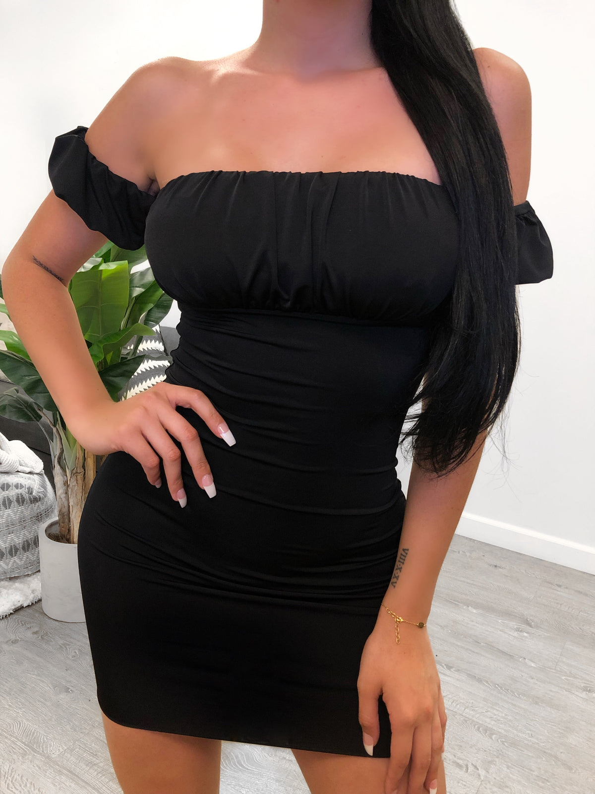black midi dress . off the shoulder dress with small sleeves around arms. Double layered. Dress comes in 3 colors.