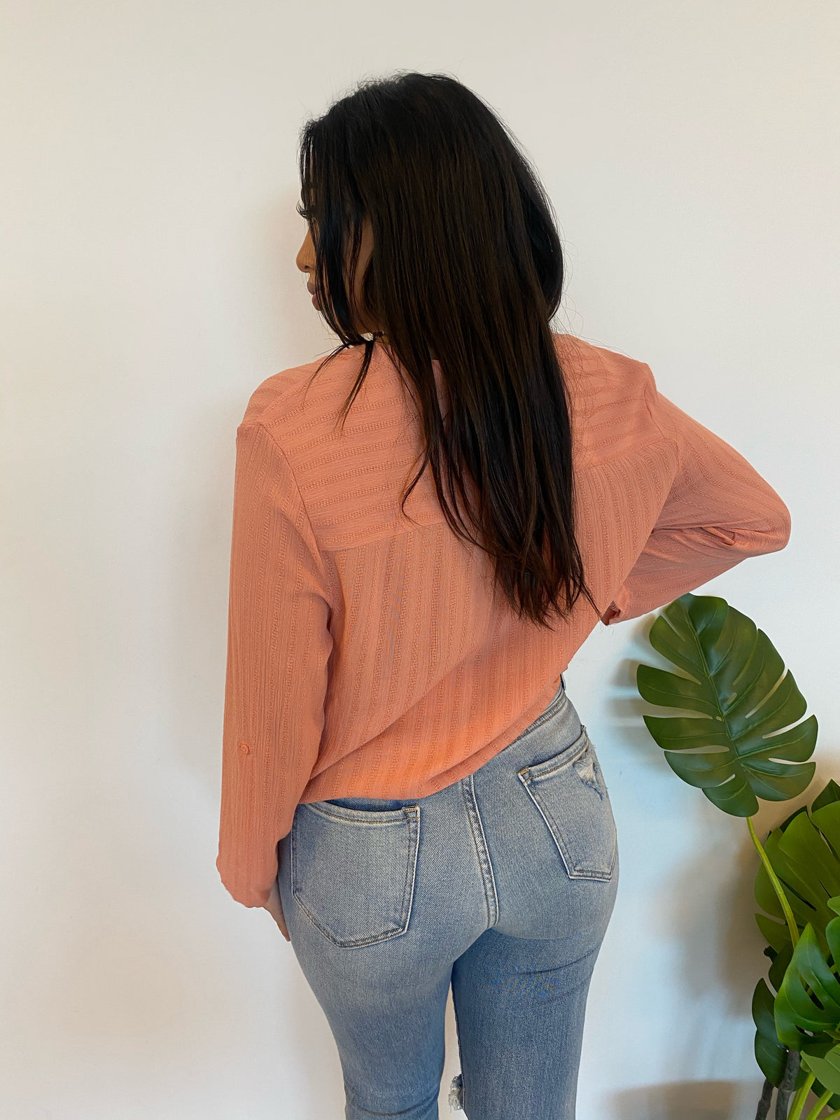 peach loose fit top, deep v cut, black button, long sleeve