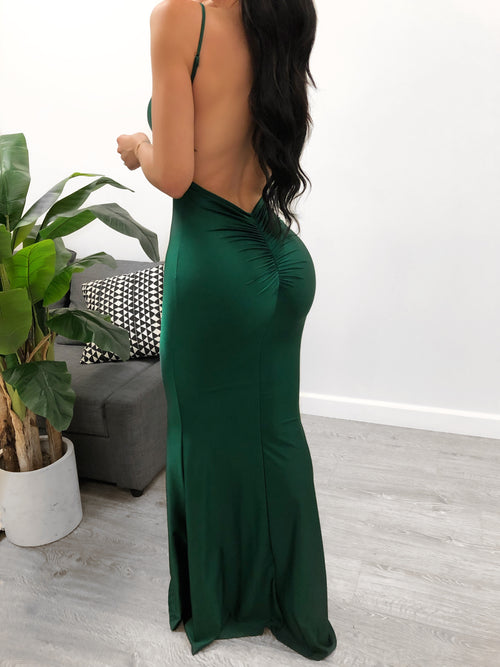 low v cut cleavage showing , spaghetti straps back drops down to above butt area, scrunched material , flowy bottoms to ankle area