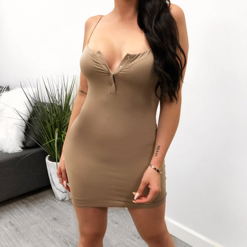 taupe spaghetti strap dress with wide square that leads to a small v cut mid cleavage. with a few snap buttons in the chest area. dress ends mid thigh