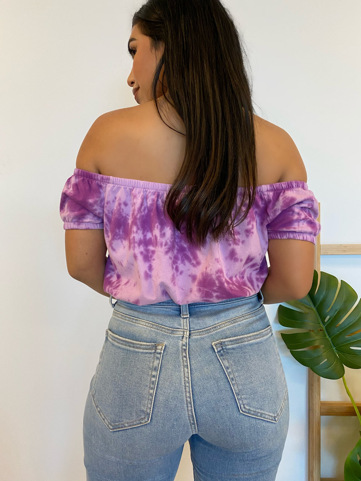 purple tie dye top, off the shoulder, elastic sleeves, above the belly button length