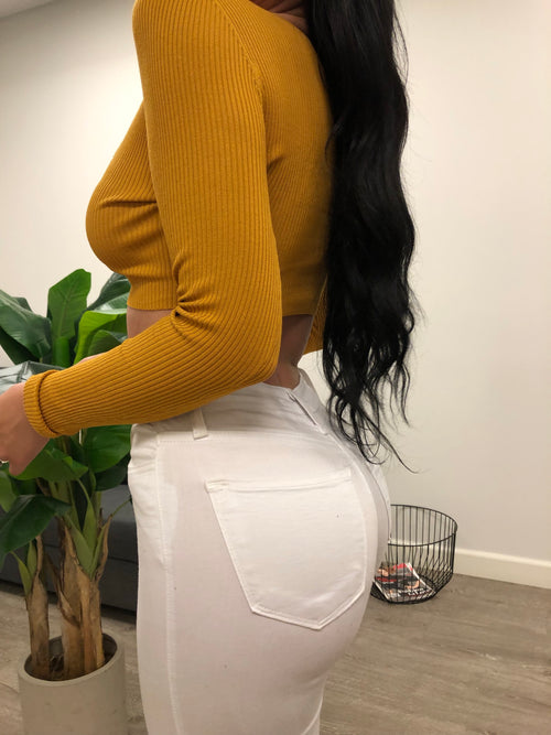 mustard long sleeve crop top, has v neckline showing mid cleavage, has buttons in the front