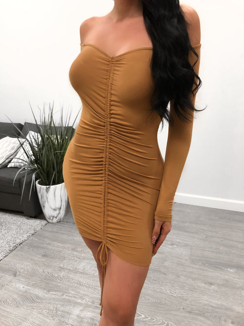 camel long sleeve off the shoulder tight dress. adjustable tie at bottom of dress to crunch dress at preference.. mid thigh length.