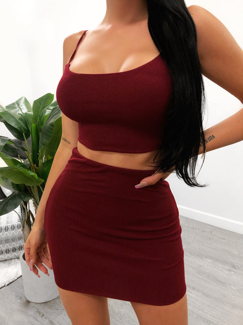 burgundy 2 piece set. crop top with adjustable spaghetti straps. skirt is above mid thigh length.