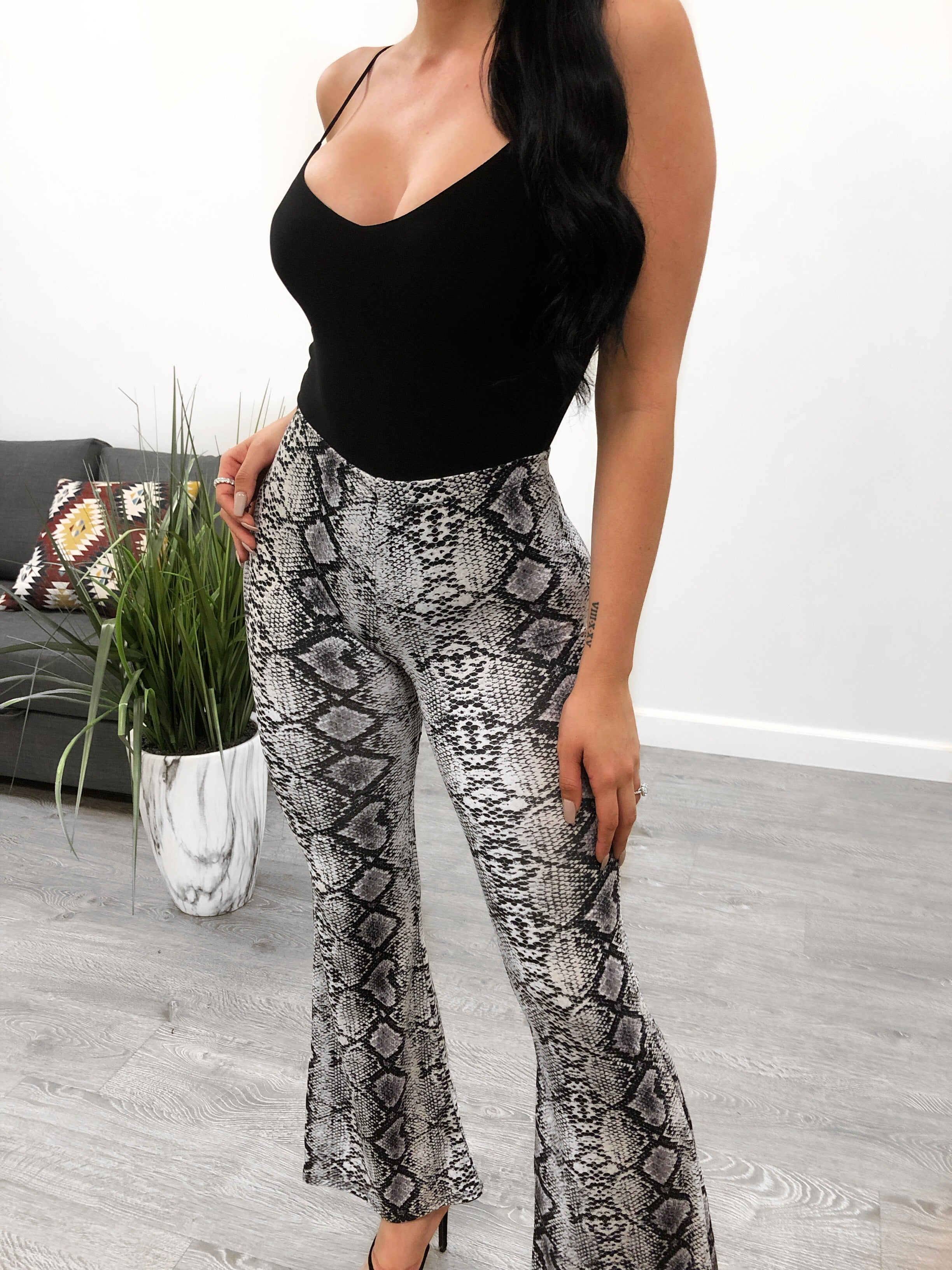 Bell bottoms in a primarily neutral color with black snake pattern.