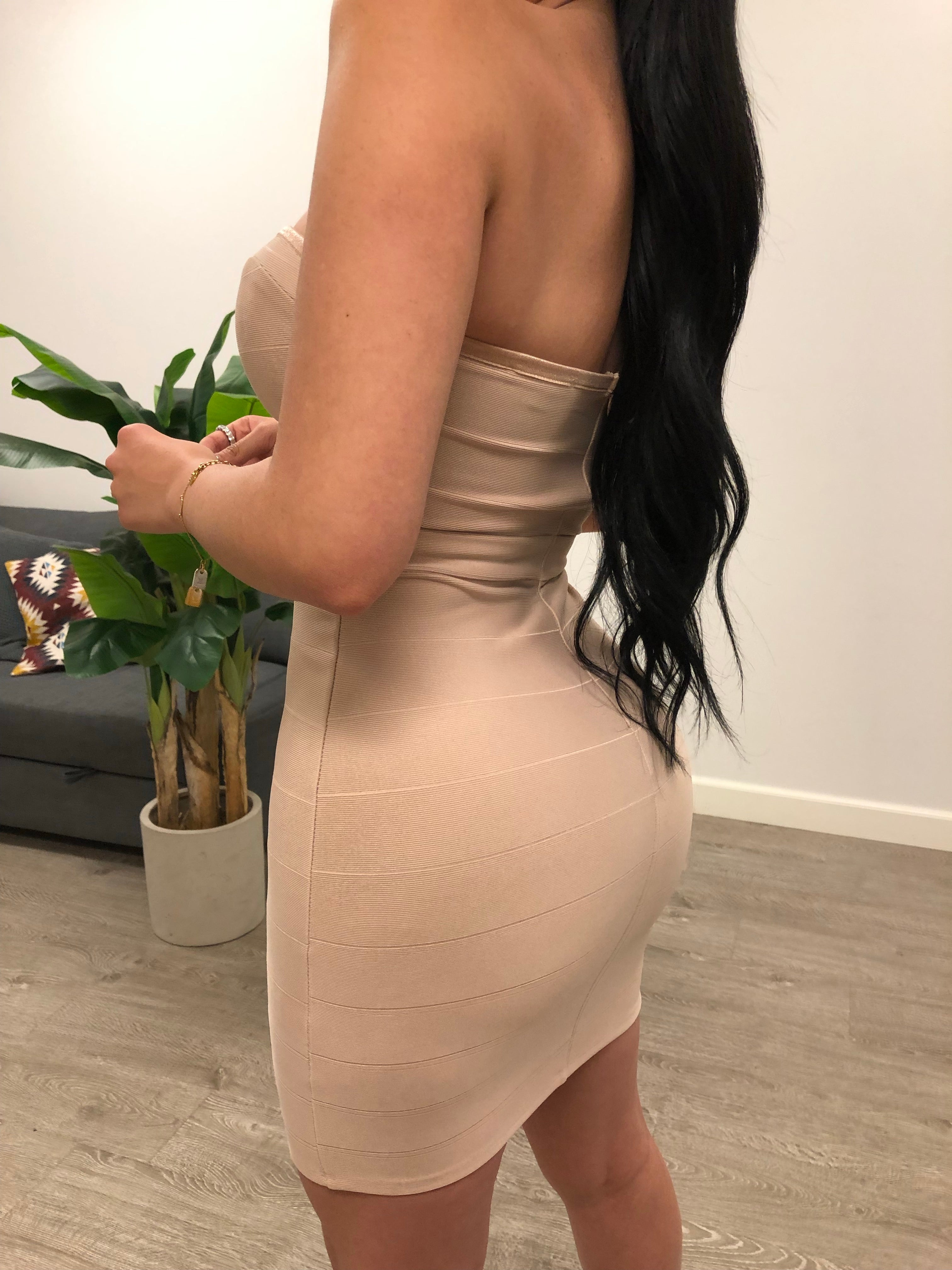 nude color strapless dress with a mesh cleavage area. dress length is to mid thigh