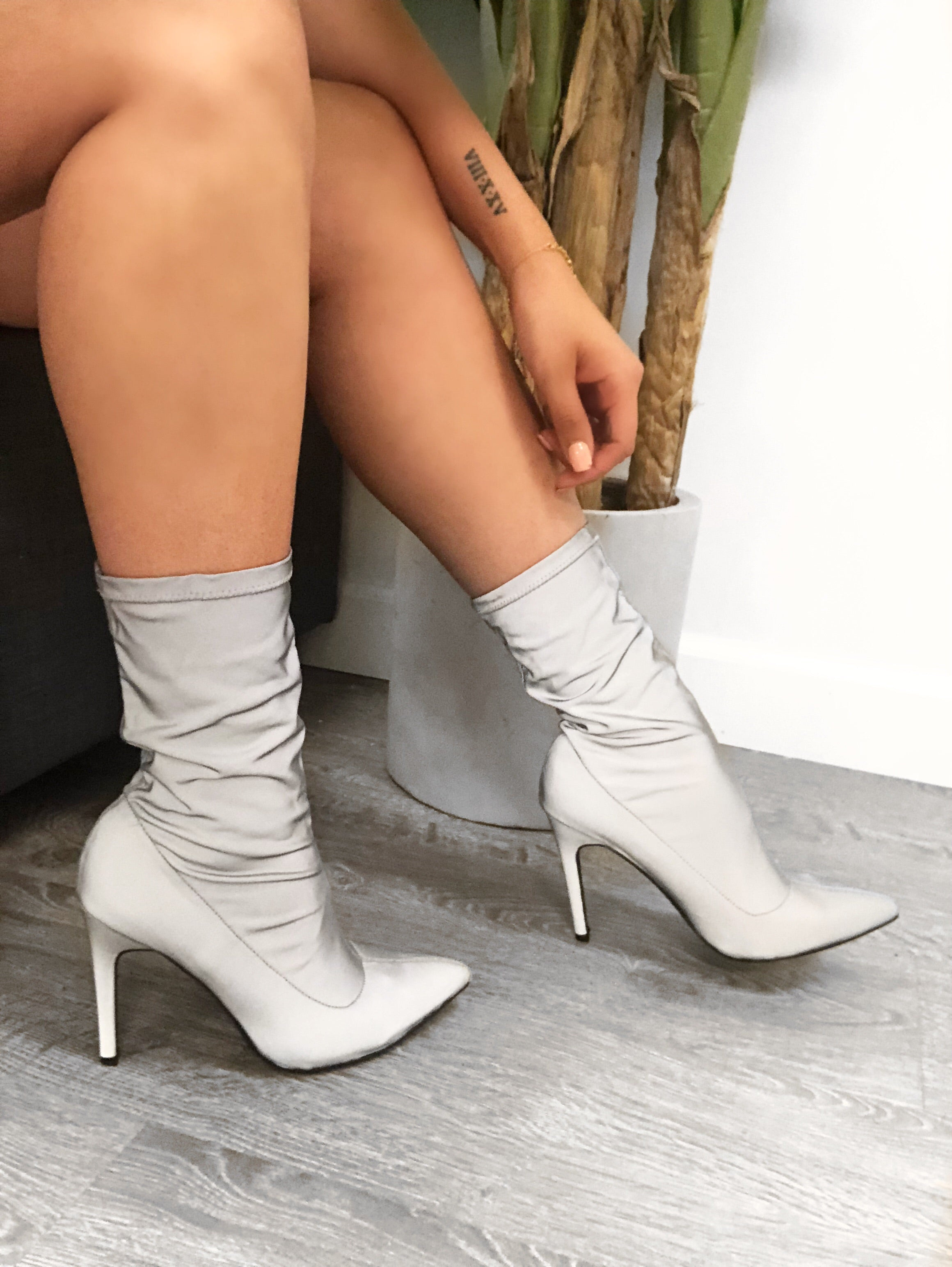 grey reflective heel booties, goes up right under calf, covers whole foot