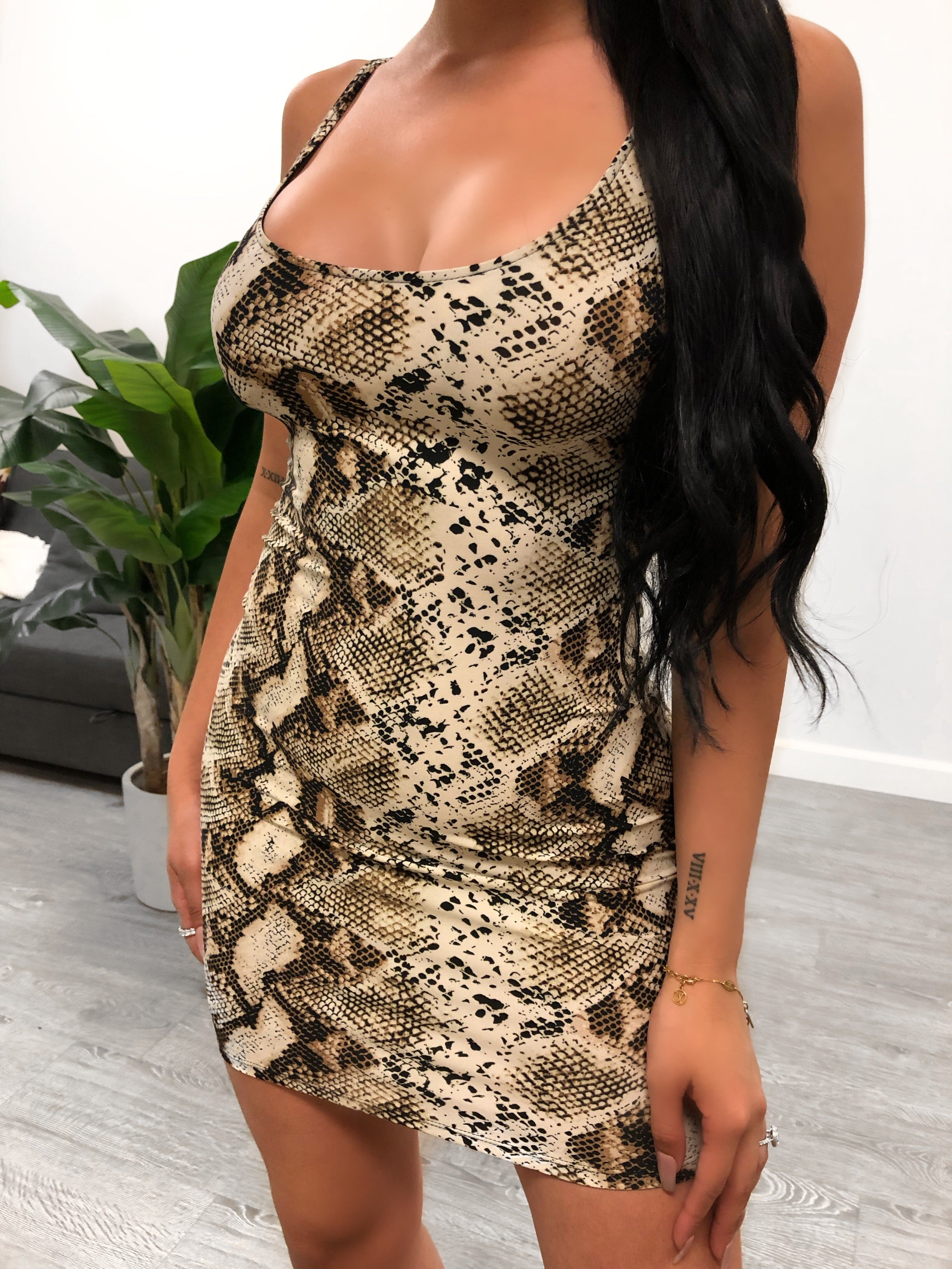Brown snake print dress. Cami dress with thicker straps. Dress is midi length. Stretchy material.