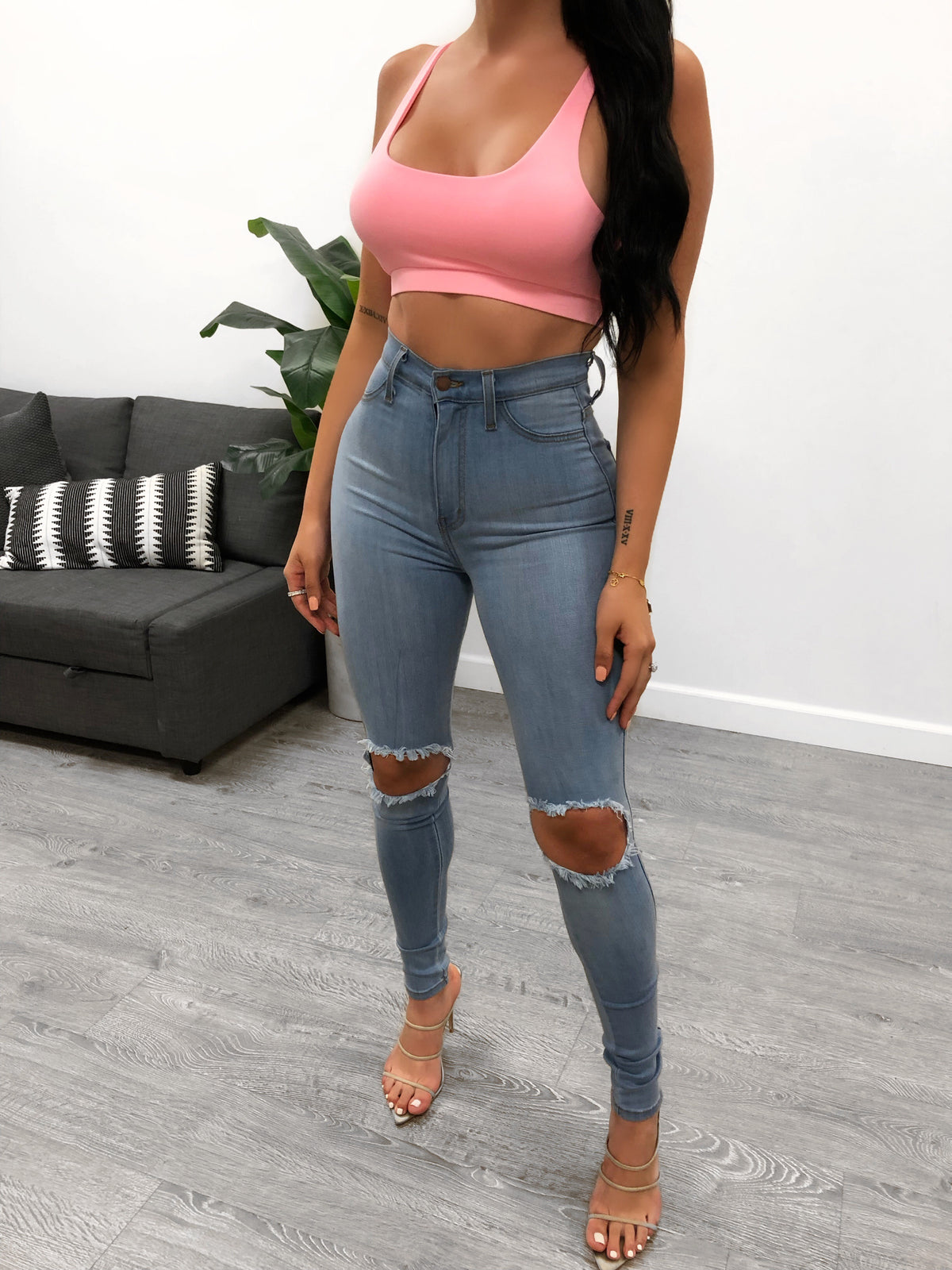 light denim high waist jeans with wide knee slits. jean length is past ankles
