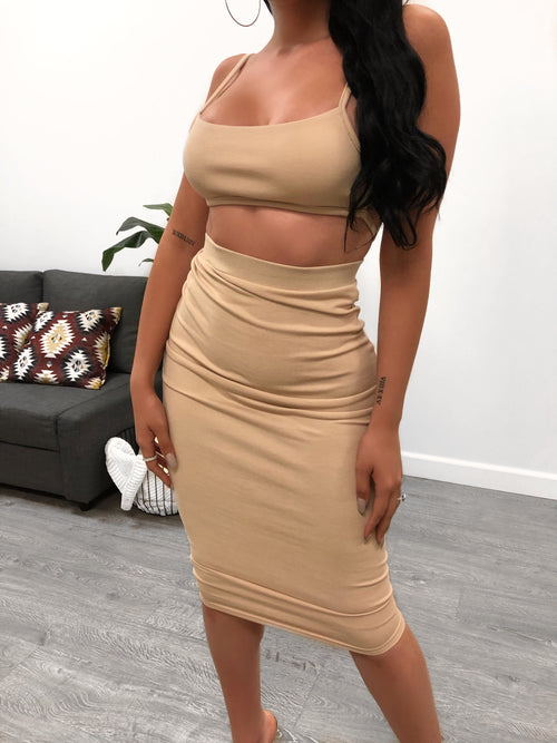 nude two piece set. backless top. non adjustable strap on back for support. high waisted skirt. skirt is below the knee length.