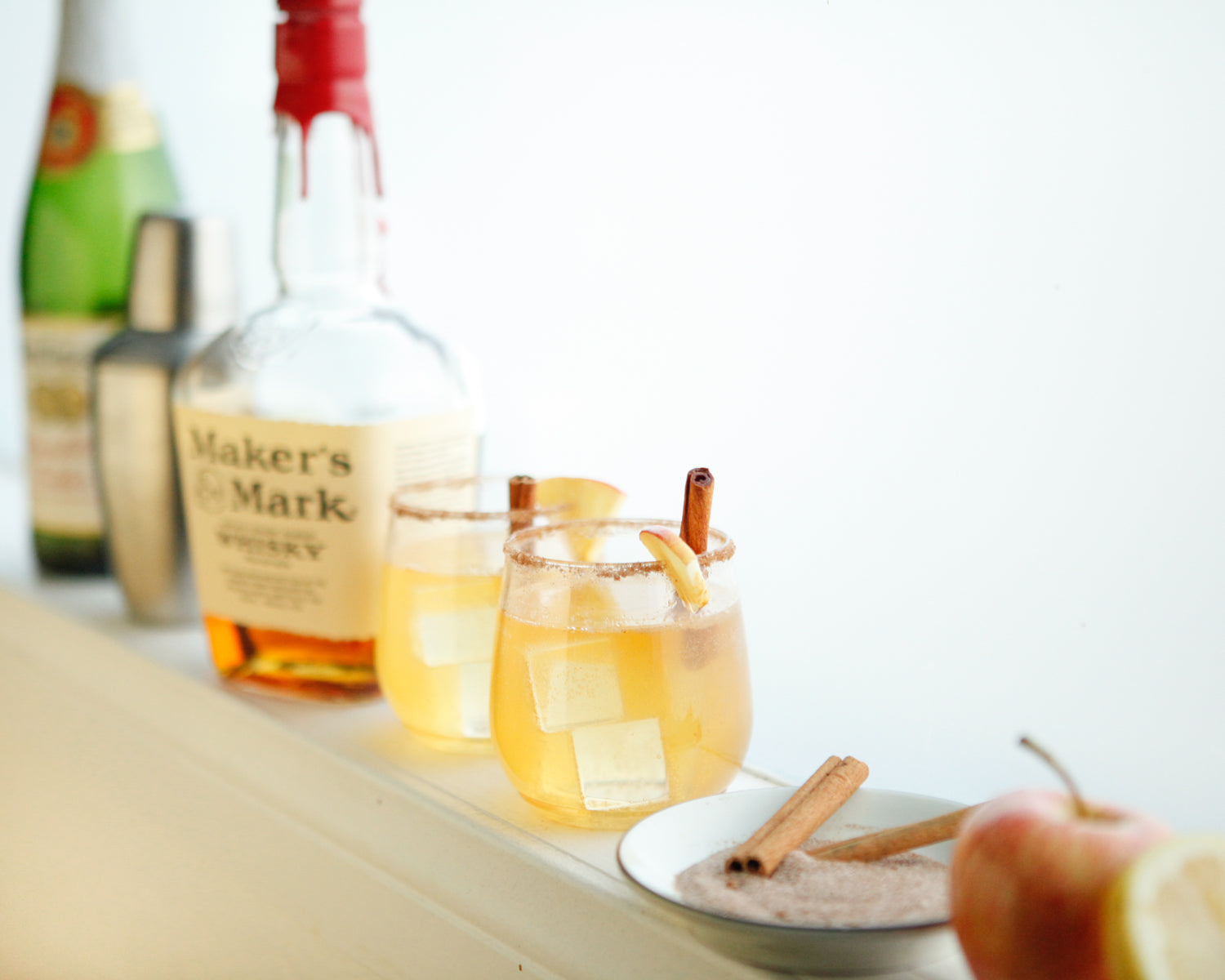 Maker's Mark, Martinelli's, shaker, and Maple Bourbon Cider cocktail shot