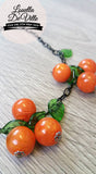 Louella DeVille Handmade Orange Bunch Necklace