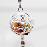 Amber filigree sphere