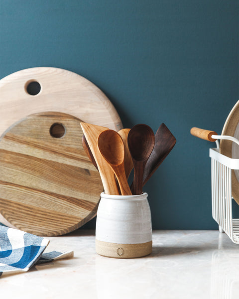 Handcrafted wooden spoons in crock in maple and walnut