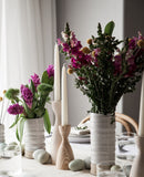 Pantry Candlesticks on tabletop with pottery vases
