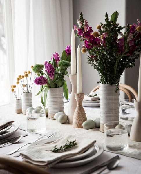 Trunk Vases with flowers on spring table