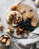Baked brie, blueberries, and bread on cheesestone