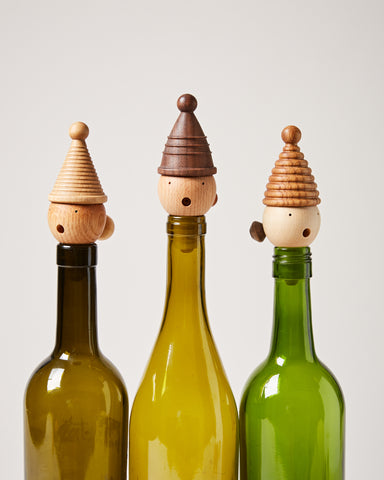 Lady Wine Stoppers in wine bottles