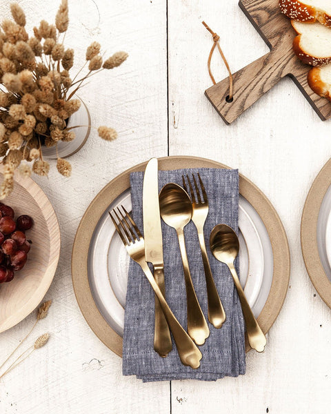 Essex Flatware in gold with dinnerware