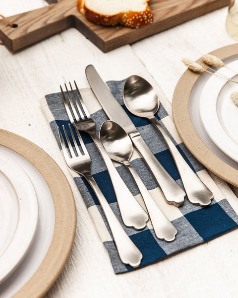 Essex Flatware in silver on gingham napkin