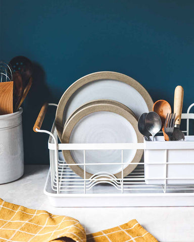 Farmers Dish Rack on countertop with dinnerware and flatware
