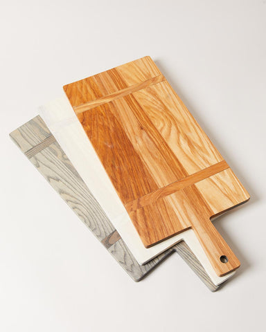 Handcrafted wood serving and charcuterie boards in natural, white, and grey