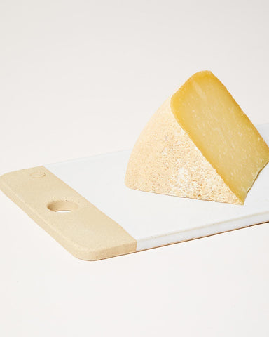 rectangular cheese stone with cheese