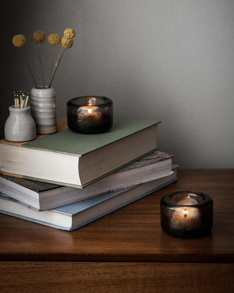 Riverstone tealight pair on books