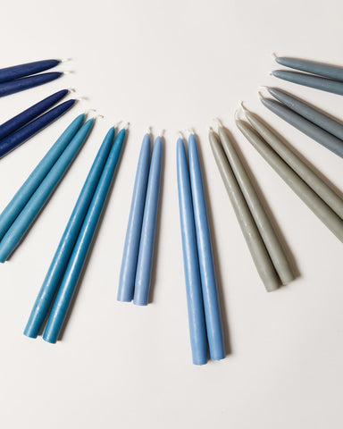 Hand-dipped taper candles in blues and grays