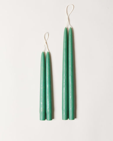 Hand-dipped taper candles in emerald