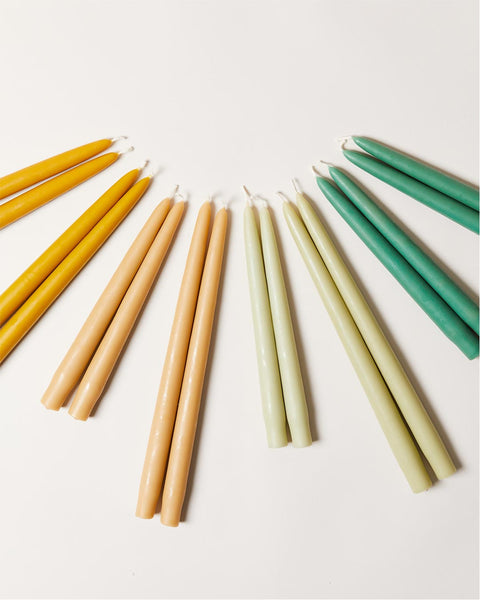 Hand-dipped taper candles in greens and golds