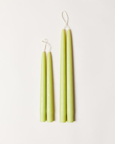 Hand-dipped taper candles in honeydew
