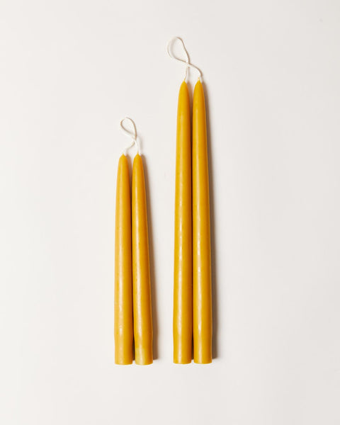 Hand-dipped taper candle in marigold