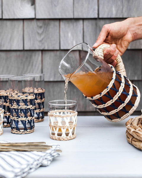 Wrapped Pitcher pouring tea into wrapped glass outdoor table