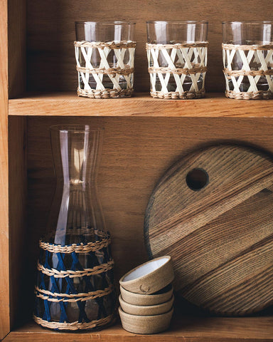 Wrapped glasses and carafe on shelf