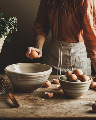 Yellowware Mixing Bowls with cracking eggs wheel thrown in Vermont
