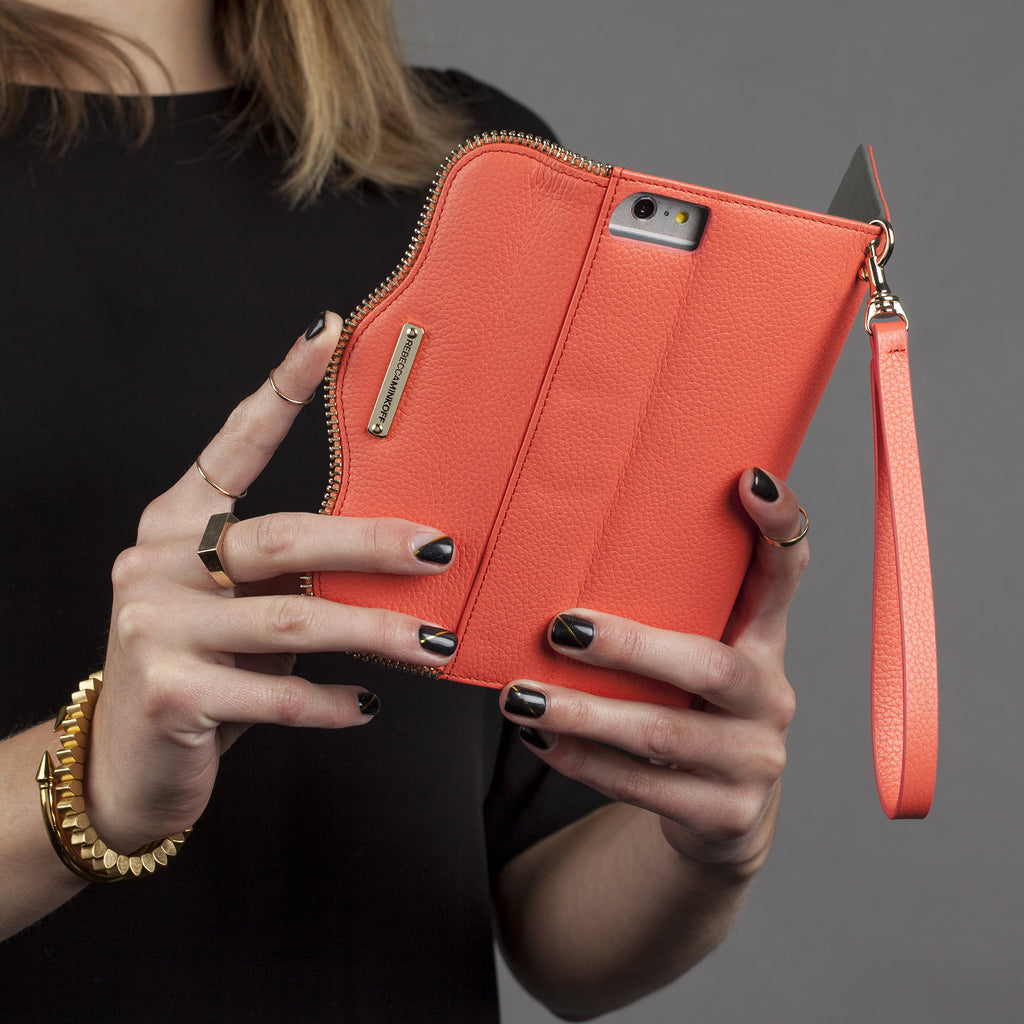 iPhone 6 Plus Coral Leather Folio Wristlet - lifestyle angle 1