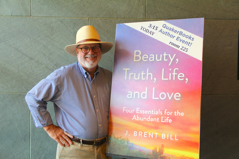 Author J. Brent Bill poses with the cover of his book at the recent FGC Gathering in Grinnell, IA
