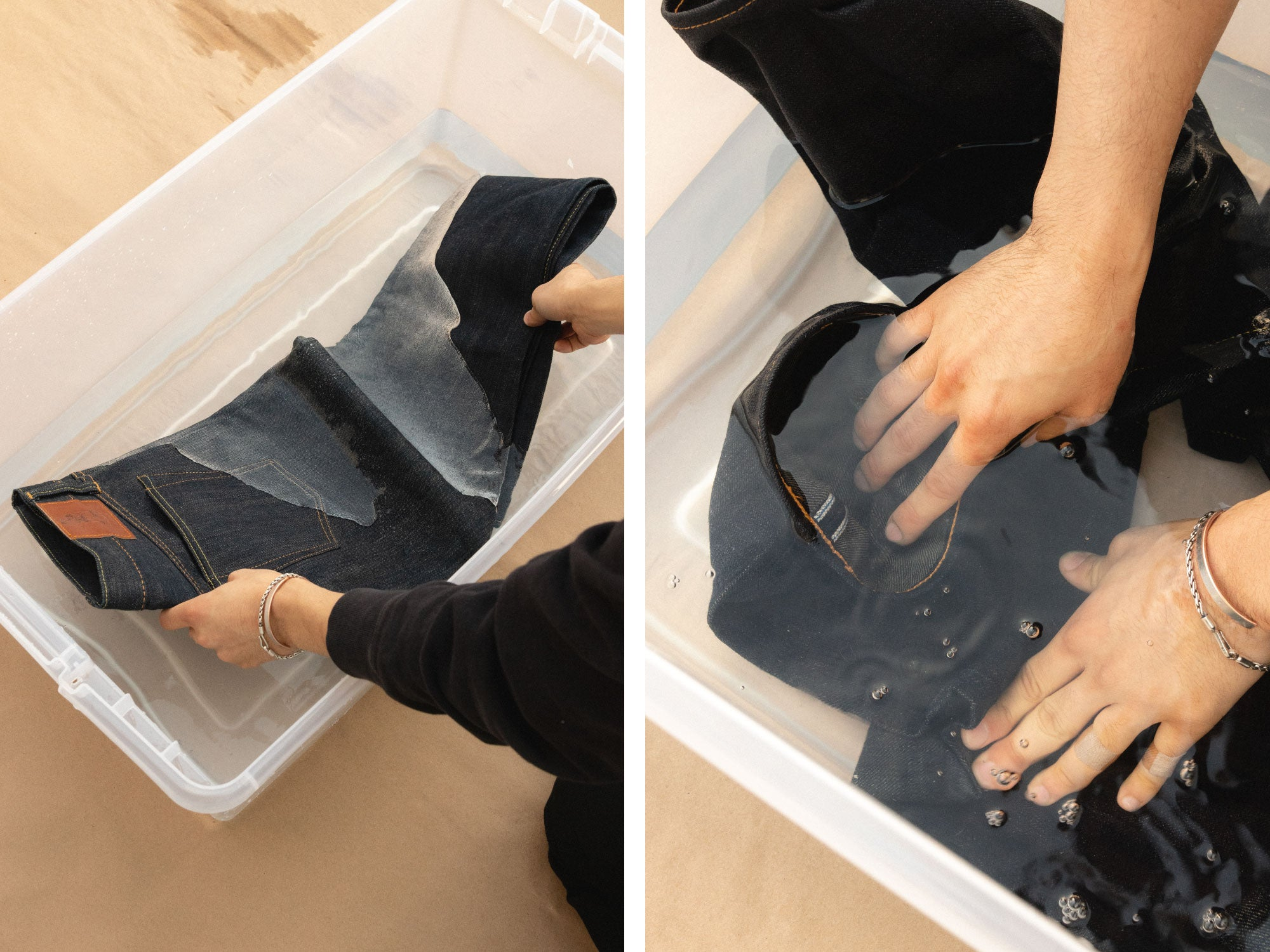 submerging denim jeans in water container