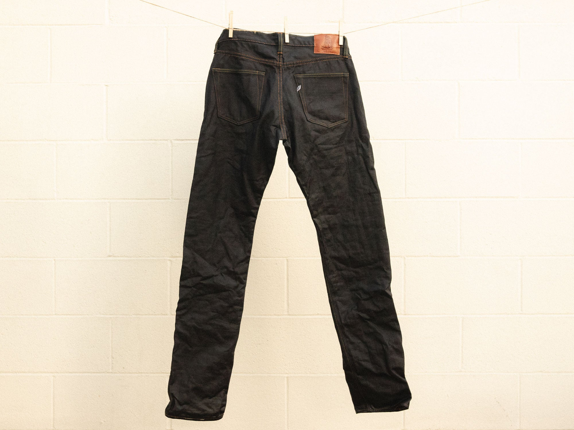 wet selvedge denim jeans hung up pure blue japan